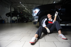 Boring young girl in repair centre Royalty Free Stock Photography