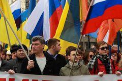 Boris Nemtsov and Ilya Yashin on the peace March in support of Ukraine. MOSCOW, RUSSIA - March 15, 2014: Boris Nemtsov and Ilya Yashin on the peace March in Royalty Free Stock Photos