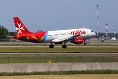 9H-AEN Air Malta Airbus A320-200 aircraft landing on the runway. Borispol, Ukraine - May 26, 2018: 9H-AEN Air Malta Airbus A320-200 aircraft landing on the Royalty Free Stock Images