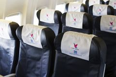 Empty economy class seats in the cabin of the 4L-MWA MyWay Airlines Boeing 737-800 aircraft royalty free stock photo