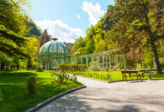 Borjomi Central Historical Park. Georgia. Source with healing mineral water. Beautiful pavilion with a glass dome Royalty Free Stock Photo