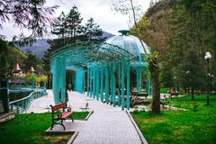 Borjomi, Samtskhe-Javakheti, Georgia. arch Entrance To Pavilion Above Hot Spring Of Borjomi Mineral Water. Famous Local Landmark Is City Park Royalty Free Stock Image