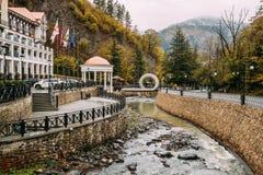 Borjomi, Samtskhe-Javakheti, Georgia. Hotel House And Pedestrian. Bridge Over River Borjomi In Shape Of A Mobius Or Moebius Loop Or Strip royalty free stock photography