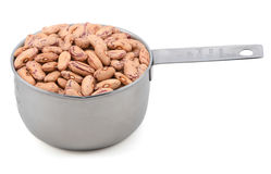 Borlotti beans in a measuring cup Stock Image