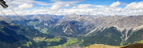 Bormio and Valtellina panorama. Color image. Panoramic view of Bormio and the Valtellina, from the peak of Bormio 2000 Lombardy, Northern Italy near the Stock Photo