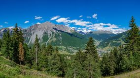 Bormio village and alps mountains huge panorama. Huge panoramic view of Bormio village and alps mountains Royalty Free Stock Images