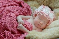 born baby girl is sleeping on fur blanket royalty free stock photos