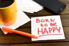 Born to be happy writing on white napkin Royalty Free Stock Photo