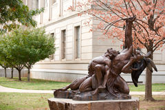 Born to Lead. Monument with Vol Walker Hall on background, University of Arkansas Royalty Free Stock Photography