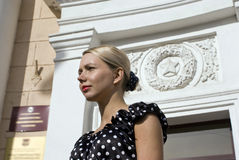 Born in the USSR. The beautiful stylish girl on a background of establishment with the Soviet symbolics Stock Photos