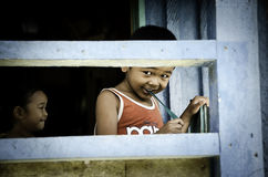 The Bornean children playing in a house Royalty Free Stock Photo