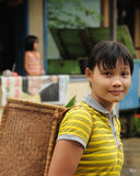 Borneo - Dayak tribal culture. The young Dayak women - vegetables seller with traditional basket from Borneo. East Kalimantan, Indonesia Stock Photo