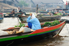 Borneo island, Indonesia - floating market in Banjarmasin. Indonesia, Borneo. For seller on the floating market near the Banjarmasin city on the Martapura river royalty free stock image