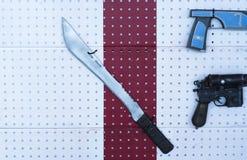 Borneo machete on the wall Stock Photography
