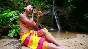 Borneo Rainforest Tribal Culture: Face Painting stock footage