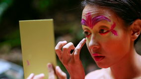 Borneo Rainforest Tribal Culture: Face Painting stock video footage
