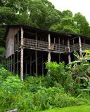 Borneo sarawak tribal longhouse architecture. A photograph of the ethnic architectural long house building of the bornean jungle tribe of Orang Ulu, native Stock Photos