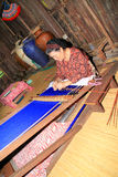 Borneo weaving. KUCHING, SARAWAK, MALAYSIA - SEPT 13: The ethnic Iban lady of Borneo weaving an exquisite decorative cloth in Kuching, Sarawak, on September 13 Royalty Free Stock Photo