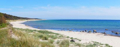 Bornholm beach, Denmark, panorama, clear sky, blue water, scenic. Panorama of the beach on Raghammer on the small Danish island in the Baltic Sea, Bornholm royalty free stock photography