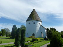 Bornholm. Denmark, Bornholm. Cute little and white church in the Olsker dating from the twelfth century stock photos
