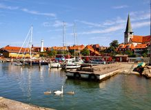 Bornholm Ronne capital. Fragment port of Ronne on the island of Bornholm. You can see the white lighthouse and the historic church Royalty Free Stock Photos