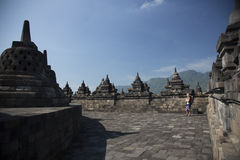 Borobodur ancient temple, Indonesia. Old carved stones and stupas of an old relgious place Stock Photos