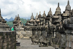 The Borobudur. Stupa is a massive, symetrical monument, 200 square meters in size, sitting upon a low sculptured hill. The monument represents a Buddhist Stock Images