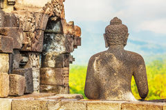 Borobudur. Buddha statue. Mountain on background. Borobudur. Java. Indonesia Royalty Free Stock Photography