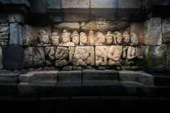 Borobudur ancient stone wall sculpture Royalty Free Stock Photos