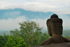 Borobudur Buddha statue overlooking the landscape Royalty Free Stock Images