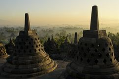 Borobudur Indonesia. Breathtaking sunrise in Borobudur Indonesia - Java. Mahayana Buddhist Temple in Magelang, Central Java. The monument consists of six square Stock Photography