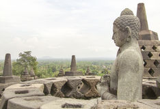 Borobudur in Java. Buddha sculpture and stupas at a temple named Borobudur located in Java, a island of Indonesia Stock Photo