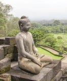 Borobudur in Java. Buddha sculpture at a temple named Borobudur located in Java, a island of Indonesia Stock Photo