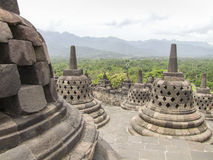 Borobudur in Java. Lots of stupas at a temple named Borobudur located in Java, a island of Indonesia Royalty Free Stock Image