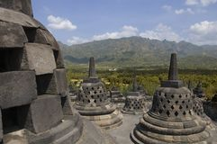 Borobudur monument. Borobodur, Indonesie - July 16, 2009 : Borobudur is a 8th-century Buddhist monument in Java. The monument was listed as a UNESCO World Stock Images