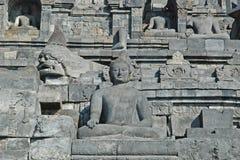 Borobudur - Muur met het standbeeld van Boedha royalty-vrije stock foto's