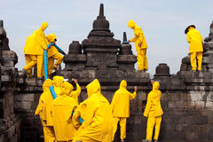 Borobudur Rescue Teamwork. A team of workers clean the Borobudur Temple in Central Java after it was covered in ash by the volcanic eruption of Mount Merapi in royalty free stock image