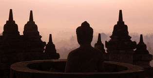 Borobudur stupa. Between the temples in the morning with a reddish sky background Royalty Free Stock Photo