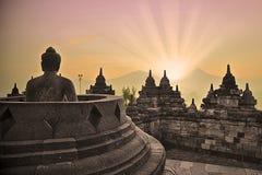 Borobudur tempel och buddha staty Arkivfoto