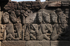Borobudur Temple, Central Java, Indonesia. Ascetic men. Stone bas relief from the Borobudur Temle in Central Java, Indonesia Royalty Free Stock Photography