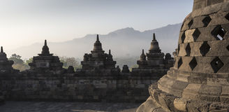 Borobudur temple complex on the island of Java in Indonesia. In the morning at sunrise Stock Photos