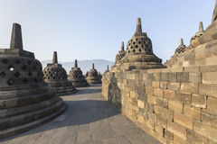 Borobudur temple complex on the island of Java in Indonesia. In the morning at sunrise Royalty Free Stock Images