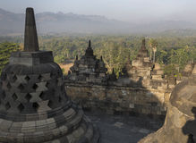 Borobudur temple complex on the island of Java in Indonesia. In the morning at sunrise Stock Photo