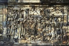 Ancient relief in Borobudur temple, Indonesia. Borobudur is the greatest Buddhist temple in the world. Located in Central Java, Indonesia. It also be the one of Royalty Free Stock Photos