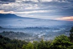 Borobudur temple in the morning mist. Sunrise over a valley with Borobudur temple in the distance Stock Image
