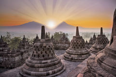 Borobudur temple and mountain at sunrise Stock Image