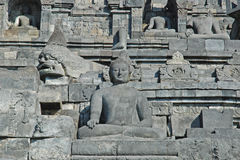Borobudur - Wall with Buddha statue's Royalty Free Stock Photos