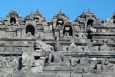 Borobudur - Wand mit Buddha-Statue Stockfotografie