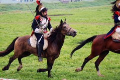 Borodino battle historical reenactment in Russia. Cuirassiers ride horses. BORODINO, MOSCOW REGION - SEPTEMBER 04, 2016: Reenactors dressed as Napoleonic war Stock Photography