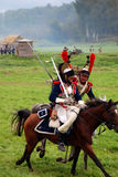 Borodino battle historical reenactment in Russia. Cuirassiers ride horses Stock Image
